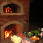 Fireplace under pizza-oven.